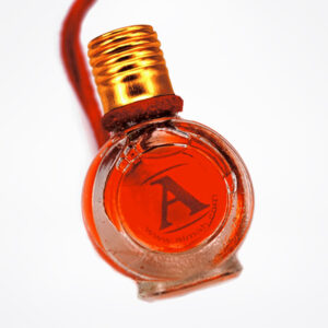 Coral red perfume bottle | Colourtherapy by ALMAH